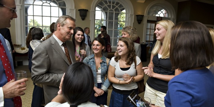 "Best-selling author John Grisham chats with law students at a reception following Tuesday's panel discussion about wrongful convictions entitled, ""Innocence and Justice."""
