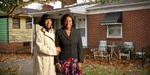 Wake Forest law student Ashleigh Wilson ('11), right, poses with homeowner Tonya Williams outside her home in Winston-Salem on Dec. 2, 2010. Wilson, a student in the Community Law and Business Clinic, was successful in preventing foreclosure proceedings with help from Professor Steve Virgil and Legal Aid of N.C.