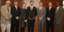 Group photo of Professor Walker and students Christopher Maner, Zoe Niesel, Douglas Ansel, David Senter Jr., and Alex Lutz, and Dean Blake Morant