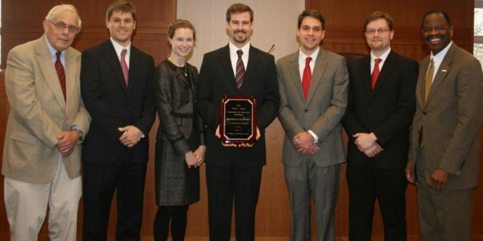 From left to right: Professor George Walker, students Christopher Maner, Zoe Niesel, Douglas Ansel, David Senter Jr., and Alex Lutz, and Dean Blake Morant