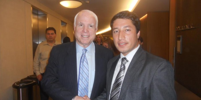 Photo of WFU Law School Afghan LL.M. candidate Yama Keshawerz and Sen. John McCain (R-Ariz.) shaking hands