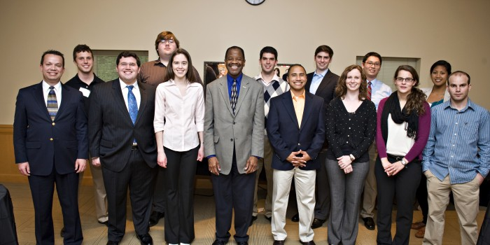 First Professionalism Certificate recipients pose with Dean Morant at reception.
