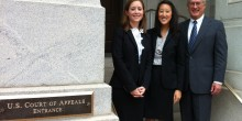 Morgan McCall ('13), Kelley Chan ('13) and Professor John Korzen, director of the Appellate Advocacy Clinic, pose outside the United States Court of Appeals for the Fourth Circuit, in Richmond, Va.