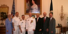 Group photo of WFU Law alumni at Admiral O'Toole's promotion and retirement ceremony: Anne Connolly O'Toole ('80), assistant counsel, NCIS; Captain Brian Lansing ('92), U.S. Navy Reserve; Rear Admiral Select Mike Quinn ('82, '85) , Assistant Judge Advocate General; Rear Admiral Dan O'Toole ('80); WFU Law Professor Charley Rose; Retired Captain Jeff Sherman ('80); and Carson Carmichael ('80), partner, Bailey & Dixon LLP of Raleigh.