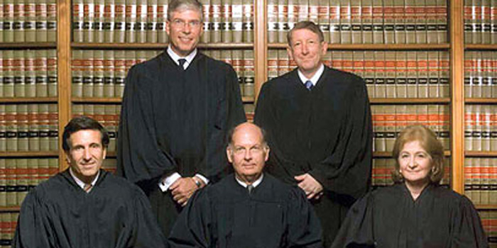 Justice Randy J. Holland, seated on the left, with the Delaware Supreme Court