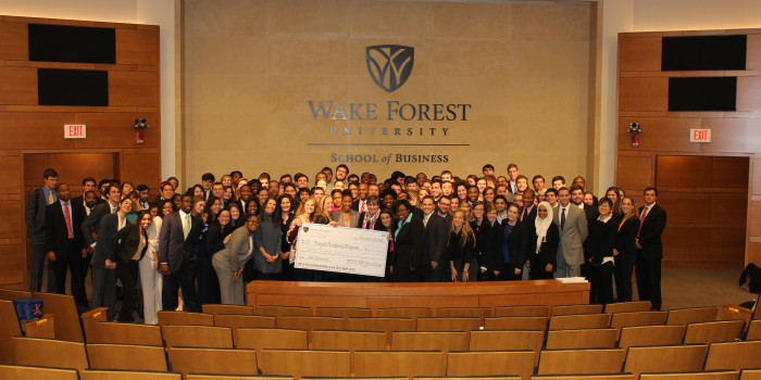 Group photo of MA business students involved in the Forsyth Backpack Program