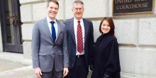 Pat Wallace ('14), Professor John Korzen ('91) and Tammy Hsu ('14) pose outside the United States Court of Appeals for the Fourth Circuit, in Richmond, Va., on Jan. 28.