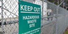 "Photo of a sign that cautions visitors outside a treatment facility at the Marine Corps base at Camp Lejeune, N.C., in 2013, which reads ""KEEP OUT: HAZARDOUS WASTE SITE: FOR ACCESS OR INFORMATION CONTACT EMD AT EXT. 5068)"
