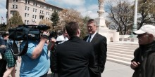 Photo of Professor John Korzen ('81 BA, '91 JD) speaking with reporters after the oral arguments in front of SCOTUS in CTS Corp. v. Waldburger.