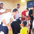 WFU players and Youth Advocacy Group volunteers with the kids and rec. center staffers.