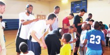 Photo of WFU mens basketball players with children at the Hanes Hosiery Community Center