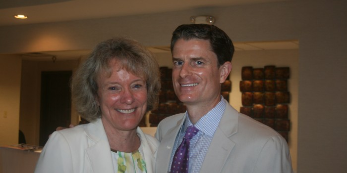 Group photo of Interim Dean Suzanne Reynolds and Coleman Cowan ('95)