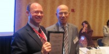 Indiana University's Andrew Klein presents Professor Michael Green with the AALS Torts Section William L. Prosser Award