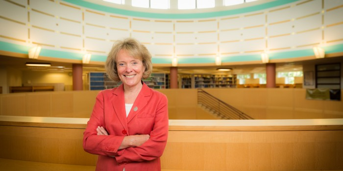 Photo of Dean Suzanne Reynolds (JD '77) in Worrell Professional Center library