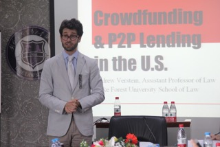 "Photo graphic of Professor Andrew Verstein presenting speech titled ""Crowdfunding & P2P Lending in the U.S."""
