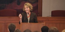 Photo of Dean Suzanne Reynolds (JD '77) speaking at podium