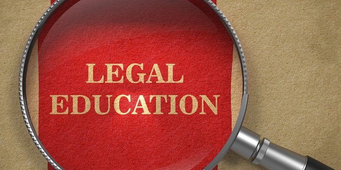 Photo graphic of magnifying glass over text 'Legal Education'