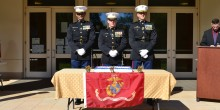 Photo of marines with cake outside of Worrell Professional Center