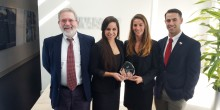 Group photo of law team with competition trophy