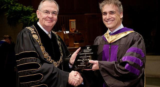 Photo of President Nathan Hatch presenting Professor Jonathan cardi his award