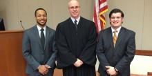Group photo of students and a judge following the Zeliff Competition final argument