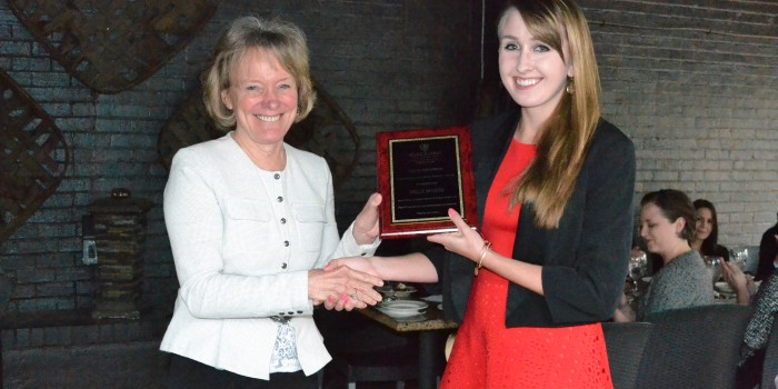 Photo of Kelly Austin (JD '16) with Dean Reynolds and her new Smith Anderson award