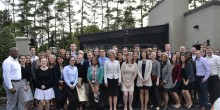Group photo of Dean Reynolds and the Pro Bono Honors Society, including 29 new inductees
