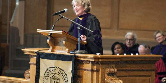 Photo of Dean Suzanne Reynolds (JD '77) speaking at the 2017 Hooding Ceremony