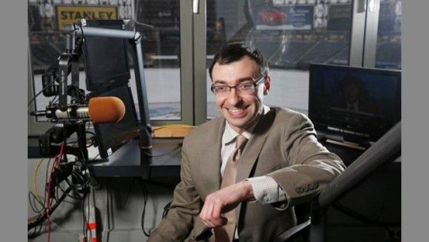 Photo of Jason Benetti (JD '11) in White Sox broadcasting booth