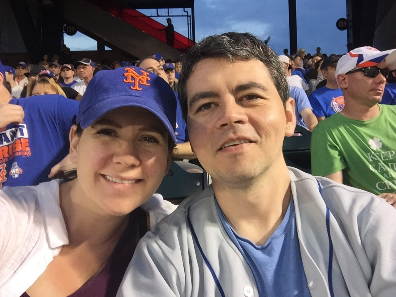 Group photo of Mary Jane Skelly (PhD '15) and Michael Klotz (JD '15) at baseball game