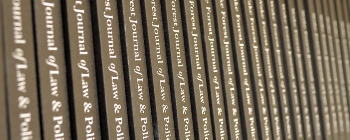 Photo of books in reoccurring row that say 'Wake Forest Journal of Law & Policy'