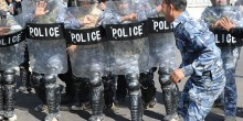 Photo of riot police in full gear