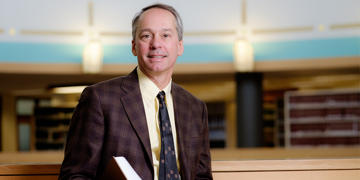 Photo of Professor Mark Hall in the Professional Library at the Worrell Professional Center
