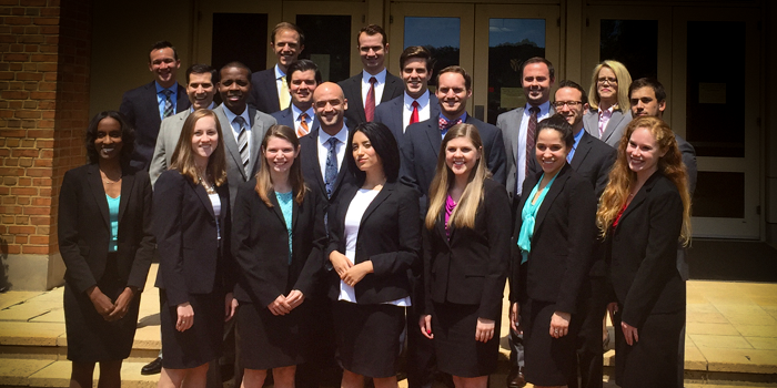 Group photo of 2016 trial team in front of Worrell Professional Center