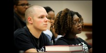 Photo of students watching panel discussing police shooting in Charlotte, NC