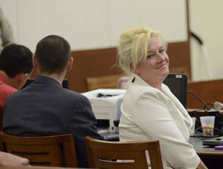 Photo of alumna, Lisa Dubs, in courtroom