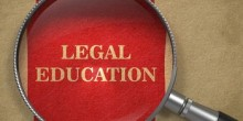Photo graphic of magnifying glass hovering over the words 'Legal Education'