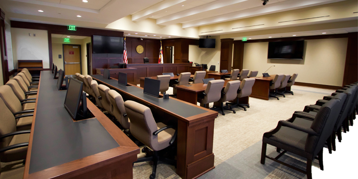 Photo of the North Carolina Business Court interior, including the bench, chairs, and desks for the jury