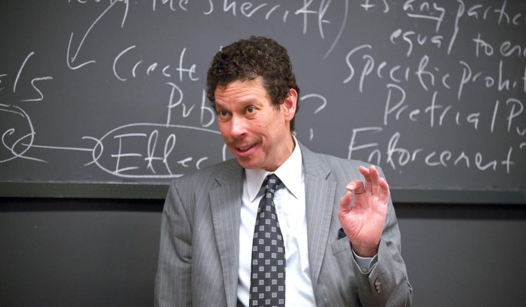 Photo of Harvard Law Professor David Wilkins in front of a chalkboard.
