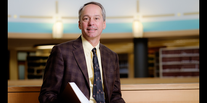 Photo of Wake Forest Law Professor Mark Hall in the Professional Library at the Worrell Professional Center