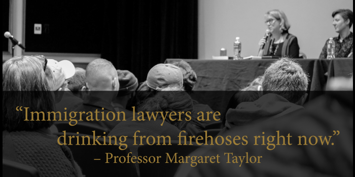 Photo graphic of Professor Margaret Taylor speaking on a panel in front of an audience at a WFU event on the 2017 Trump Immigration ban with a block quote stating,'Immigration lawyers are drinking from firehoses right now. - Professor Margaret Taylor'