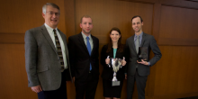 Group photo of Coach and Professor John Korzen (JD '91) and National Moot Court Champions holding their trophies, including Matt Cloutier (JD '17), Mia Falzarano (JD '17), and Blake Stafford (JD '17)