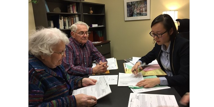 Photo of law student meeting with two clients at the Wake Forest School of Law Elder Law clinic