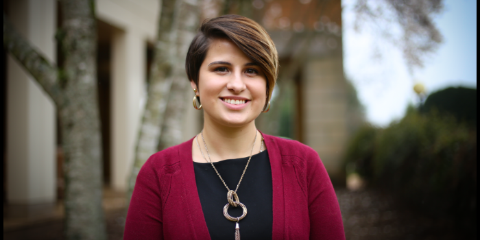 Photo of Wake Forest School of Law student Audrey Koncsol outside the Worrell Professional Center