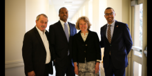 Group photo of Thomas Sager, Professor Omari Simmons, Dean Suzanne Reynolds, and Sashi Brown of the Cleveland Browns following Sager Speaker Series event.