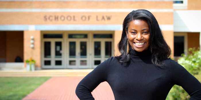 Photo of law student Jasmine Gregory (JD '18) posing in front of the Worrell Professional Center