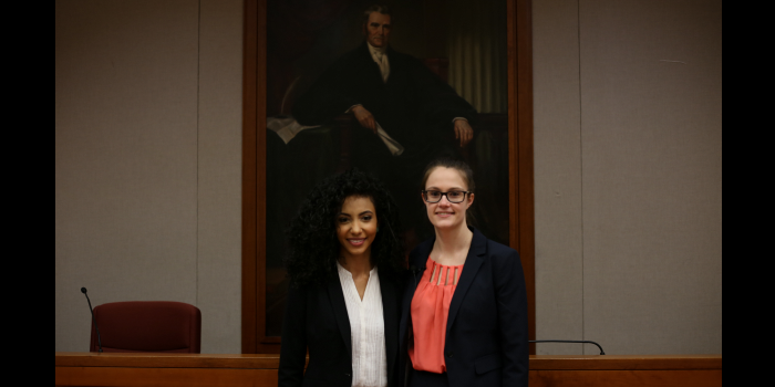 Group photo of the 2017 Zeliff Trial Bar Competition finalists, Cheslie Kryst (JD '17) and Ashley DiMuzio (JD '17) in the Worrell Professional Center courtroom