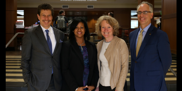 Group photo of Professor David Wilkins, Professor Kami Simmons, Dean Suzanne Reynolds, and Provost Rogan Kersh