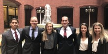 Photo of some of the members of the D.C. Summer Judicial Externship Program pose in front of a fountain