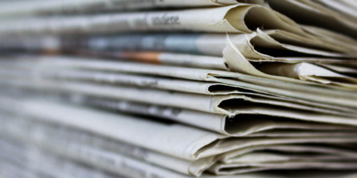 Photo of a stock of newspapers
